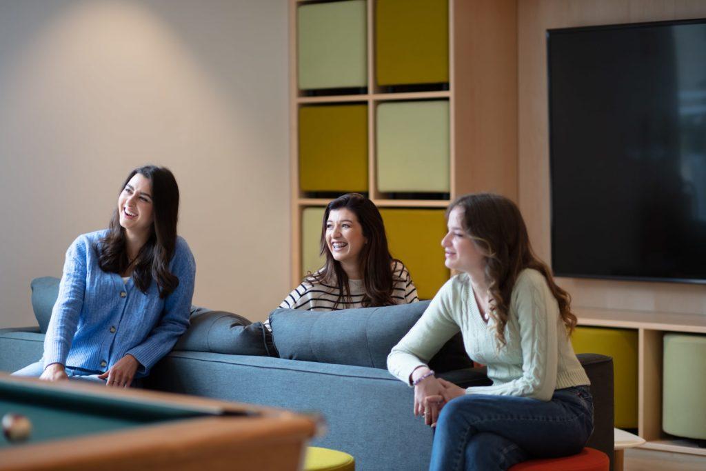 Three people sat on a sofa